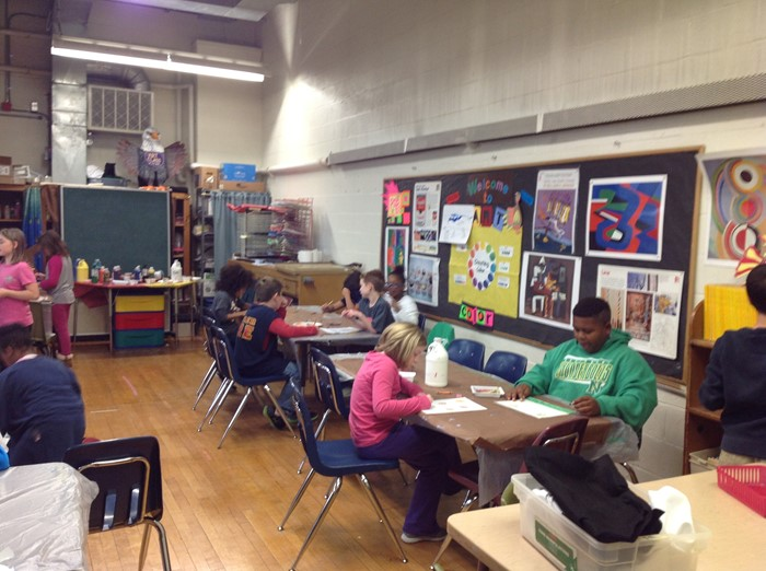 4th graders painting to music