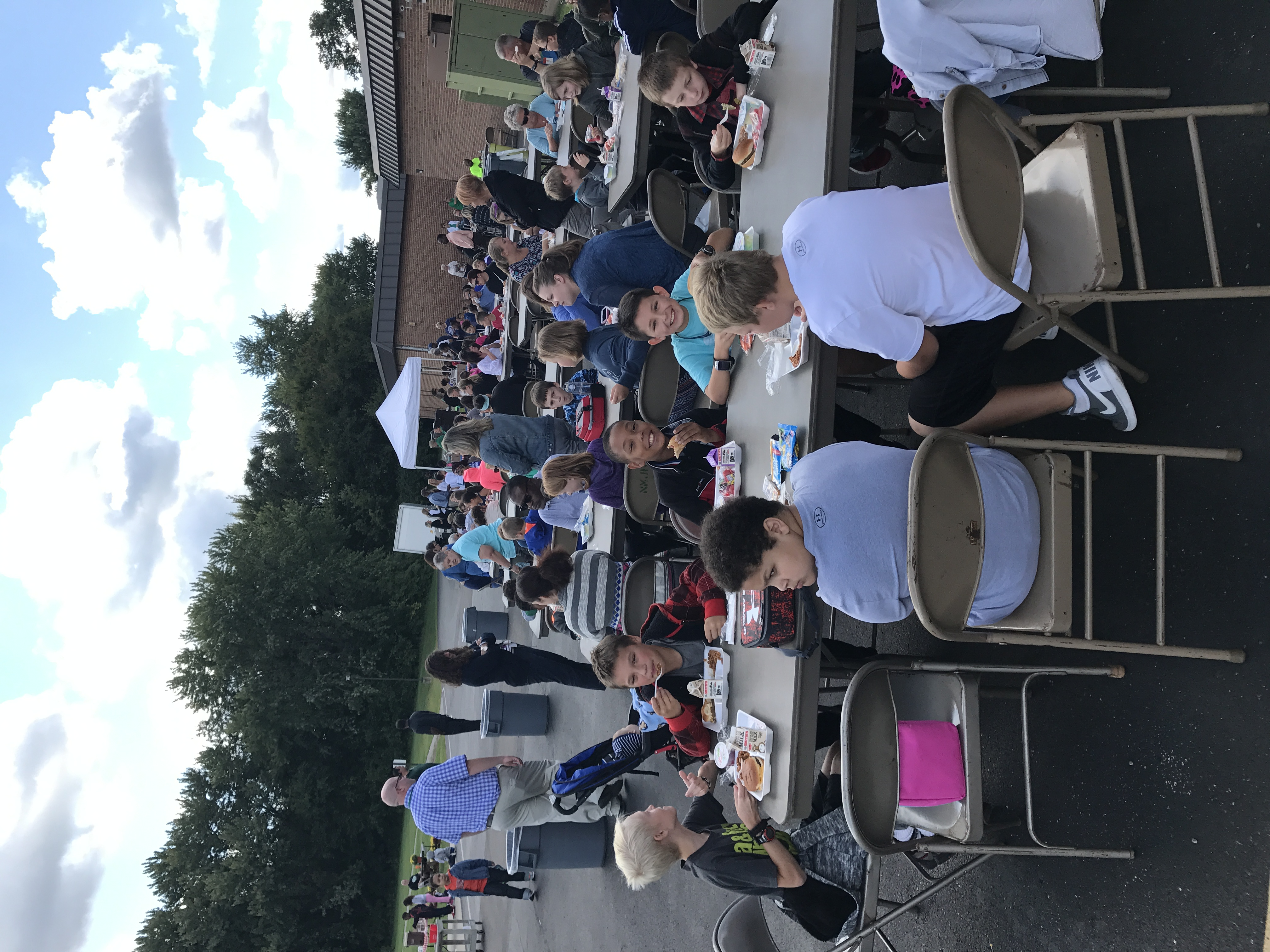 Students and families eating at the Fall BBQ